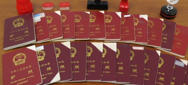 Canada Border Services Agency released this picture of passports seized from Xun Wang, as part of an investigation into his immigration fraud scheme. (CBSA)